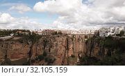 Купить «Aerial view of Ronda landscape and buildings with Puente Nuevo Bridge, Andalusia, Spain», видеоролик № 32105159, снято 18 апреля 2019 г. (c) Яков Филимонов / Фотобанк Лори