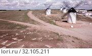 Купить «Picturesque view of windmills in Campo de Criptana municipality, Spain», видеоролик № 32105211, снято 23 апреля 2019 г. (c) Яков Филимонов / Фотобанк Лори