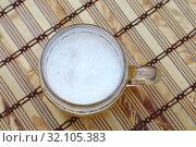 Glass mug of unfiltered weizen beer on table. Стоковое фото, фотограф Anton Eine / Фотобанк Лори