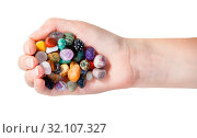 Top view of handful with various gems isolated on white background. Стоковое фото, фотограф Zoonar.com/Valery Voennyy / easy Fotostock / Фотобанк Лори
