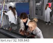 Купить «Children playing in bunker quest room», фото № 32109843, снято 21 октября 2017 г. (c) Яков Филимонов / Фотобанк Лори
