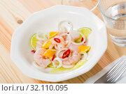 Купить «Ceviche with shrimps, lime, orange», фото № 32110095, снято 21 ноября 2019 г. (c) Яков Филимонов / Фотобанк Лори