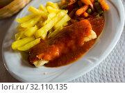 Codfish fillet with tomato sauce. Стоковое фото, фотограф Яков Филимонов / Фотобанк Лори
