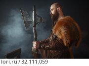 Купить «Viking with axe, barbarian, side view», фото № 32111059, снято 27 марта 2019 г. (c) Tryapitsyn Sergiy / Фотобанк Лори