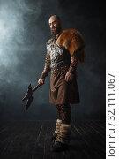 Купить «Handsome viking with axe, nordic barbarian image», фото № 32111067, снято 27 марта 2019 г. (c) Tryapitsyn Sergiy / Фотобанк Лори