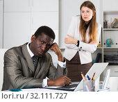 Купить «Tired man manager sitting at table and angry woman boss», фото № 32111727, снято 16 сентября 2019 г. (c) Яков Филимонов / Фотобанк Лори