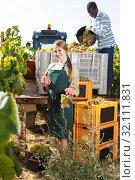 Male and female vineyard workers inspecting new grapes harvest. Стоковое фото, фотограф Яков Филимонов / Фотобанк Лори