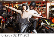 couple having fun at motorcycle salon after buying new bike. Стоковое фото, фотограф Яков Филимонов / Фотобанк Лори