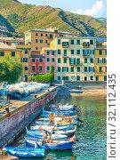 Купить «Fishing boats and waterfront in Genoa Nervi», фото № 32112435, снято 1 июля 2019 г. (c) Роман Сигаев / Фотобанк Лори