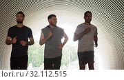 Купить «young men or male friends running outdoors», видеоролик № 32112515, снято 27 июля 2019 г. (c) Syda Productions / Фотобанк Лори