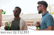 Купить «happy male friends drinking beer at rooftop party», видеоролик № 32112551, снято 27 июля 2019 г. (c) Syda Productions / Фотобанк Лори