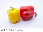Купить «Red and yellow sweet bell pepper on a white background, selective focus», фото № 32113859, снято 2 сентября 2019 г. (c) Сергей Краснощеков / Фотобанк Лори