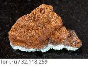 Macro shooting of natural mineral rock specimen - rough bog iron ore ( limonite) stone on dark granite background from Taman Peninsula, Russia. Стоковое фото, фотограф Zoonar.com/Valery Voennyy / easy Fotostock / Фотобанк Лори