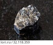 Купить «Macro shooting of natural mineral rock specimen - broken crystal of Schorl (black tourmaline) gemstone on dark granite background from Madagascar», фото № 32118359, снято 19 февраля 2020 г. (c) easy Fotostock / Фотобанк Лори