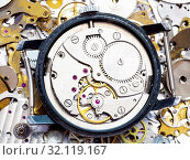 Купить «Watchmaker workshop - open old mechanical wristwatch on pile of clock spare parts», фото № 32119167, снято 29 января 2020 г. (c) easy Fotostock / Фотобанк Лори