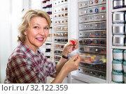 mature woman in sewing store. Стоковое фото, фотограф Яков Филимонов / Фотобанк Лори
