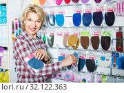Купить «mature woman customer in sewing store», фото № 32122363, снято 16 сентября 2019 г. (c) Яков Филимонов / Фотобанк Лори