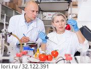 Купить «Scientists taking notes while checking agricultural products», фото № 32122391, снято 24 января 2019 г. (c) Яков Филимонов / Фотобанк Лори