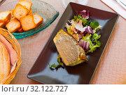 Купить «Delicious pie prepared with leek and served with salad», фото № 32122727, снято 15 июля 2019 г. (c) Яков Филимонов / Фотобанк Лори