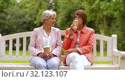 Купить «senior women or friends drinking coffee at park», видеоролик № 32123107, снято 25 августа 2019 г. (c) Syda Productions / Фотобанк Лори