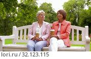 Купить «senior women or friends drinking coffee at park», видеоролик № 32123115, снято 25 августа 2019 г. (c) Syda Productions / Фотобанк Лори
