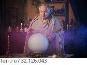 Купить «elderly wizard with crystal ball», фото № 32126043, снято 4 августа 2019 г. (c) Майя Крученкова / Фотобанк Лори