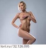 Купить «Attractive blonde gracefully posing nude», фото № 32126095, снято 9 февраля 2016 г. (c) Гурьянов Андрей / Фотобанк Лори
