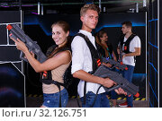 Купить «Team of laser tag guy and girl with laser pistols and friends in background», фото № 32126751, снято 27 августа 2018 г. (c) Яков Филимонов / Фотобанк Лори