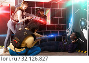 Купить «group of adult people with laser guns having fun», фото № 32126827, снято 23 января 2019 г. (c) Яков Филимонов / Фотобанк Лори