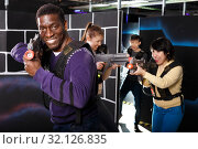 Купить «African man playing laser tag with friends», фото № 32126835, снято 23 января 2019 г. (c) Яков Филимонов / Фотобанк Лори