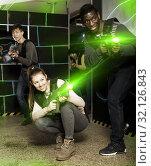 Купить «Multiracial couple playing lasertag», фото № 32126843, снято 23 января 2019 г. (c) Яков Филимонов / Фотобанк Лори