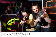 Купить «two emotional female laser tag players having fun in multinational team», фото № 32126851, снято 23 января 2019 г. (c) Яков Филимонов / Фотобанк Лори