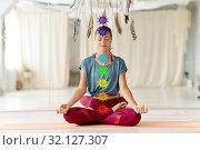Купить «woman meditating in lotus pose at yoga studio», фото № 32127307, снято 21 июня 2018 г. (c) Syda Productions / Фотобанк Лори
