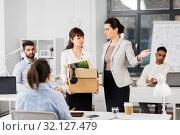 Купить «fired sad female office worker leaving», фото № 32127479, снято 23 марта 2019 г. (c) Syda Productions / Фотобанк Лори