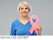 Купить «old woman with pink breast cancer awareness ribbon», фото № 32127607, снято 28 апреля 2019 г. (c) Syda Productions / Фотобанк Лори