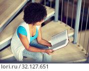 Купить «african student girl reading book at library», фото № 32127651, снято 19 июня 2016 г. (c) Syda Productions / Фотобанк Лори