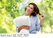 Купить «happy young woman in pajama with pillow», фото № 32127707, снято 6 марта 2019 г. (c) Syda Productions / Фотобанк Лори