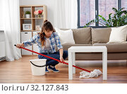 Купить «happy asian woman with mop cleaning floor at home», фото № 32127843, снято 13 апреля 2019 г. (c) Syda Productions / Фотобанк Лори