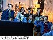 Купить «happy friends with drinks watching tv at home», фото № 32128239, снято 22 декабря 2018 г. (c) Syda Productions / Фотобанк Лори