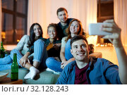 Купить «happy friends taking selfie by smartphone at home», фото № 32128243, снято 22 декабря 2018 г. (c) Syda Productions / Фотобанк Лори