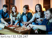 Купить «friends eating pizza and drinking red wine at home», фото № 32128247, снято 22 декабря 2018 г. (c) Syda Productions / Фотобанк Лори