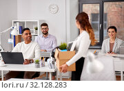 Купить «happy employee with personal stuff at office», фото № 32128283, снято 23 марта 2019 г. (c) Syda Productions / Фотобанк Лори