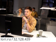 Купить «man with computer working late at night office», фото № 32128439, снято 26 ноября 2017 г. (c) Syda Productions / Фотобанк Лори
