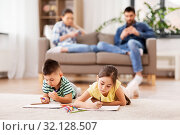 Купить «brother and sister drawing with crayons at home», фото № 32128507, снято 31 марта 2019 г. (c) Syda Productions / Фотобанк Лори