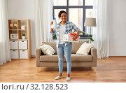 Купить «woman with basket and laundry detergent at home», фото № 32128523, снято 7 апреля 2019 г. (c) Syda Productions / Фотобанк Лори