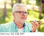 Купить «old man using voice command recorder on smartphone», фото № 32128591, снято 9 июля 2016 г. (c) Syda Productions / Фотобанк Лори
