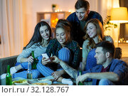 Купить «friends with smartphone watching tv at home», фото № 32128767, снято 22 декабря 2018 г. (c) Syda Productions / Фотобанк Лори