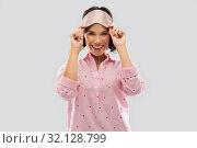 Купить «happy young woman in pajama and eye sleeping mask», фото № 32128799, снято 6 марта 2019 г. (c) Syda Productions / Фотобанк Лори