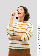 Купить «woman in striped pullover pointing her finger up», фото № 32128815, снято 6 марта 2019 г. (c) Syda Productions / Фотобанк Лори