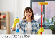 Купить «asian woman with window detergent and sponge mop», фото № 32128859, снято 13 апреля 2019 г. (c) Syda Productions / Фотобанк Лори